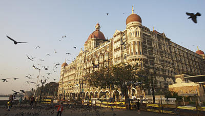Flock Of Bird Photograph - Taj Mahal Palace Hotel Mumbai, India by Chris Caldicott