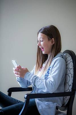 Teenage Girl Using A Smartphone Print by Samuel Ashfield