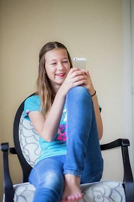 Teenage Girl Using Smartphone Print by Samuel Ashfield