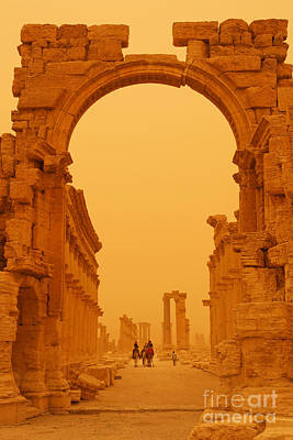 Camel Photograph - The Monumental Arch At Palmyra Syria In The Light After A Sandstorm by Robert Preston