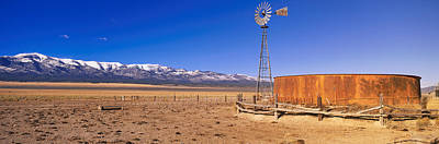 Old West Photograph - This Is An Old Wooden Windmill In An by Panoramic Images