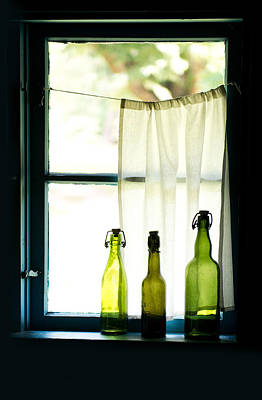 Three Green Glass Bottles And The Window Print by Jaroslaw Blaminsky