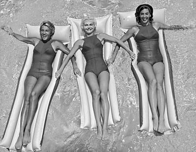 Inflatable Photograph - Three Women Floating In A Pool by Underwood Archives