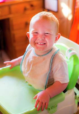 Candid Photograph - Toddler In A High Chair by Samuel Ashfield