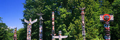 Stanley Park Photograph - Totem Poles In A A Park, Stanley Park by Panoramic Images