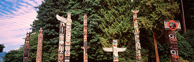 Indigenous Culture Photograph - Totem Poles In A Park, Stanley Park by Panoramic Images