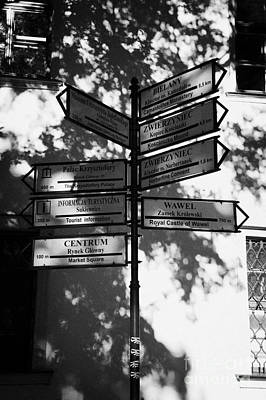 Polish City Photograph - Tourist Pedestrian Signs To Tourist Attractions In Krakow Old Town Square by Joe Fox