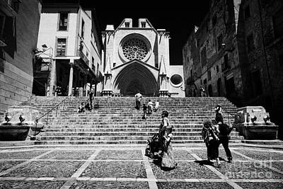 Front Steps Photograph - Tourists On Steps Leading Up To Facade Of Tarragona Cathedral Catalonia Spain by Joe Fox