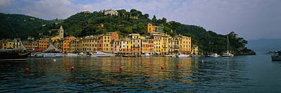 Reflections Of Sky In Water Photograph - Town At The Waterfront, Portofino, Italy by Panoramic Images