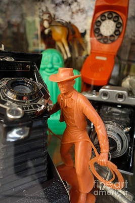 Hand Photograph - Toy Cowboy Vintage Cameras Old Phone by Amy Cicconi