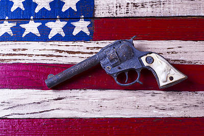Toy Gun On Wooden Flag Print by Garry Gay