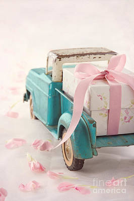 Toy Truck Carrying A Gift Box With Pink Ribbon Print by Anna-Mari West