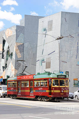 Light Photograph - Traditional And Modern Symbols Of Melbourne - Tram And Architecture by David Hill