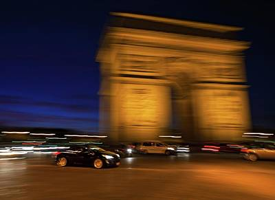 Traffic At The Arc De Triomphe Print by Babak Tafreshi