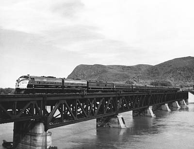 Land Feature Photograph - Train Crossing A Trestle by Underwood Archives