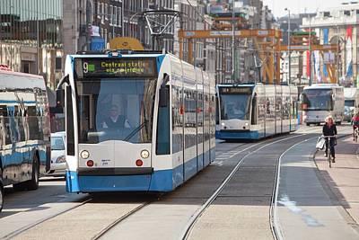 Tram In Amsterdam Print by Ashley Cooper