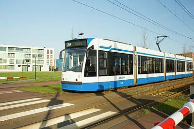 Tram In Ijburg Print by Ashley Cooper