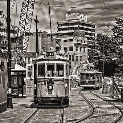 Trams In Cathedral Square Christchurch New Zealand Print by Colin and Linda McKie