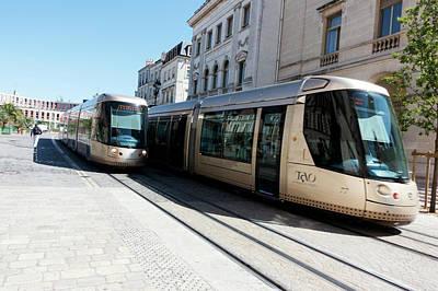 Trams In Orleans Print by Louise Murray