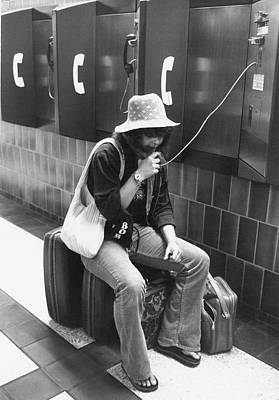 Traveler Talks On Pay Phone Print by Underwood Archives