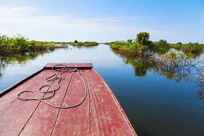 Traveling Through Tonle Sap Lake Print by Alexey Stiop