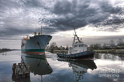 Tugboat Pulling A Cargo Ship Print by Olivier Le Queinec