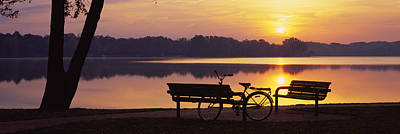 Reflections Of Sky In Water Photograph - Two Benches With A Bicycle by Panoramic Images