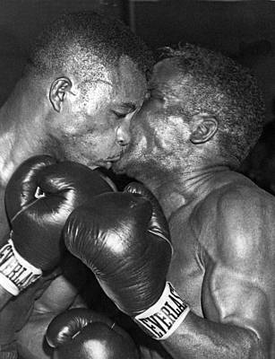 Boxing Gloves Photograph - Two Boxers In A Clinch by Underwood Archives