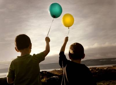 Two Children With Balloons Print by Con Tanasiuk