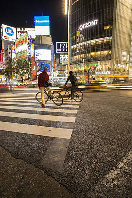 Shibuya Photograph - Two Cyclists In Shibuya by Ruben Vicente
