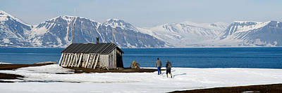 Log Cabin Photograph - Two Hikers Standing On The Beach by Panoramic Images