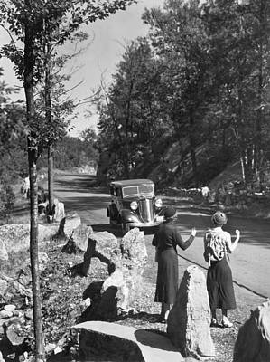 Anticipation Photograph - Two Young Women Hitchhiking by Underwood Archives