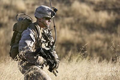 U.s. Marine Patrols Across The Hills Print by Stocktrek Images