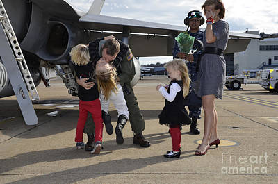 Husband Waiting Photograph - U.s. Navy Aviator Is Reunited by Stocktrek Images