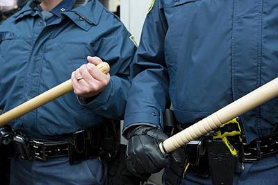 Us Police With Batons Print by Jim West