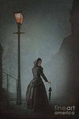 Victorian Woman Under Streetlamp In Fog Print by Lee Avison