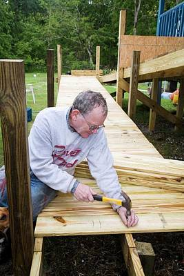 Altruism Photograph - Volunteer Building A Wheelchair Ramp by Jim West