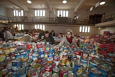 Altruism Photograph - Volunteers At A Food Bank by Jim West