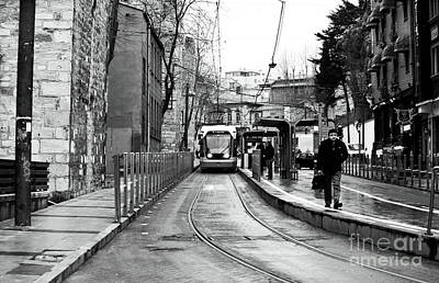 Waiting For The Tram In Istanbul Print by John Rizzuto