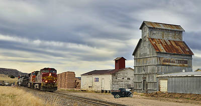 Sante Fe Photograph - Warbonnet Passing The Grain Elevator by Ken Smith