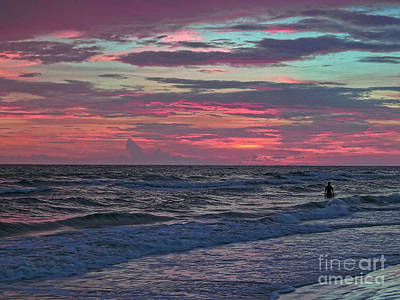 Clouds Photograph - Watching The Sanibel Sunset by Jeff Breiman