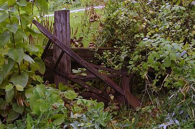 Horse-drawn Plow Photograph - Where An Old Plow Rests  by Jeff Swan