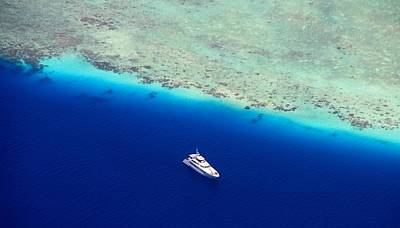 White Diving Boat Staying At Coral Reef Print by Jenny Rainbow
