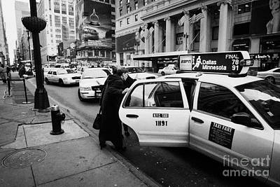 white middle aged passengers exit from yellow cab rear door at taxi rank on 7th Avenue Print by Joe Fox