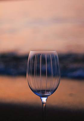 Wine Glass On The Beach At Sunset Print by Dan Sproul