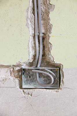 Wiring A Socket Into A House Wall Print by Ashley Cooper