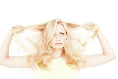 Blonde Hair Photograph - Woman Holding Long Blonde Hair by Ian Hooton