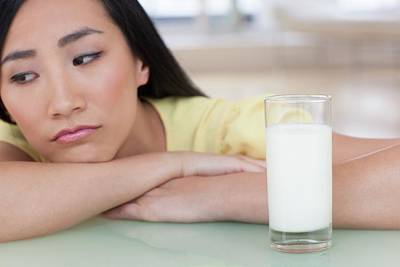 Woman Looking Sad With Glass Of Milk Print by Ian Hooton