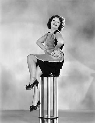 Pedestal Photograph - Woman On A Pedestal by Underwood Archives