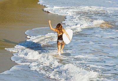 Woman Running Along Beach Print by Ben Welsh